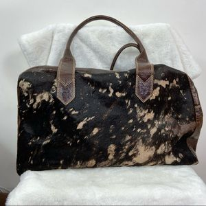 Brown Cow hair fur leather purse/overnight bag. Distressed